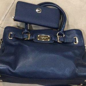 Michael Kors purse/wallet set.